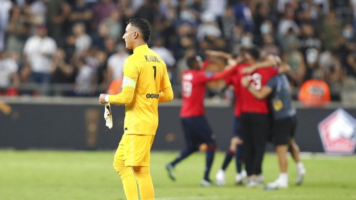 PSGs goalkeeper Keylor Navas walks at the end of the French Super Cup final soccer match between Lille and Paris Saint-Germain at Bloomfield Stadium in Tel Aviv, Israel, Sunday, Aug. 1, 2021. (AP Photo/Ariel Schalit)