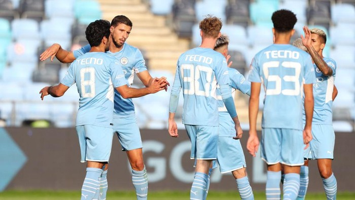MANCHESTER, ENGLAND - AUGUST 03: Ilkay Gundogan of Manchester City celebrates with Ruben Dias after scoring their sides third goal during the Pre-Season Friendly match between Manchester City and Blackpool at Manchester City Football Academy on August 03, 2021 in Manchester, England. (Photo by Lewis Storey/Getty Images)