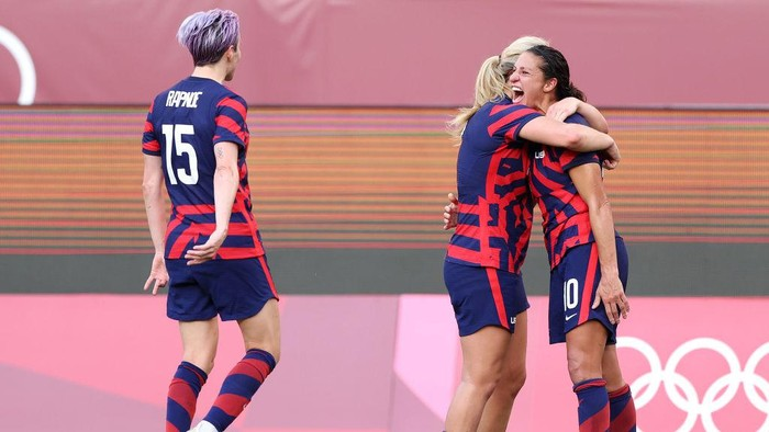 KASHIMA, JAPAN - AUGUST 05: Carli Lloyd #10 of Team United States celebrates with Lindsey Horan #9 after scoring their sides third goal during the Womens Bronze Medal match between United States and Australia on day thirteen of the Tokyo 2020 Olympic Games at Kashima Stadium on August 05, 2021 in Kashima, Japan. (Photo by Elsa/Getty Images)