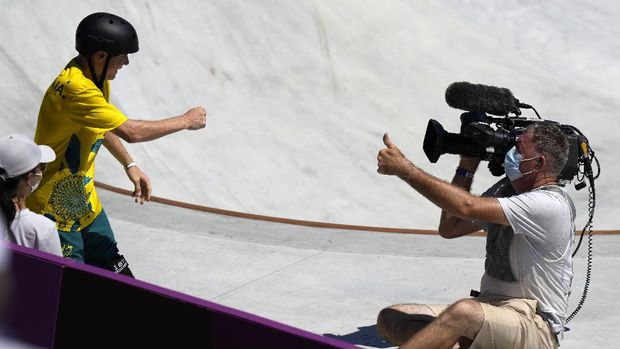 Kieran Woolley of Australia crashes in to a cameraman during the men's park skateboarding prelims at the 2020 Summer Olympics, Thursday, Aug. 5, 2021, in Tokyo, Japan. (AP Photo/Ben Curtis)