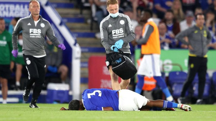 LEICESTER, ENGLAND - AUGUST 04: Medics run over to an injured Wesley Fofana of Leicester City during a Pre Season Friendly match between Leicester City and Villarreal CF at The King Power Stadium on August 04, 2021 in Leicester, England. (Photo by Alex Pantling/Getty Images)