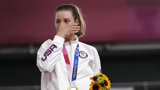 Gold medalist Jennifer Valente of Team United States reacts during medal ceremony for the track cycling women's omnium points race at the 2020 Summer Olympics, Sunday, Aug. 8, 2021, in Izu, Japan. (AP Photo/Christophe Ena)