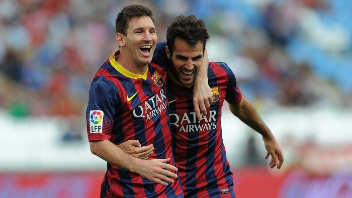 ALMERIA, SPAIN - SEPTEMBER 28:  Lionel Messi (L) celebrates with Cesc Fabregas after scoring FC Barcelonas opening goal during the La Liga match between UD Almeria and FC Barcelona on September 28, 2013 in Almeria, Spain.  (Photo by Denis Doyle/Getty Images)