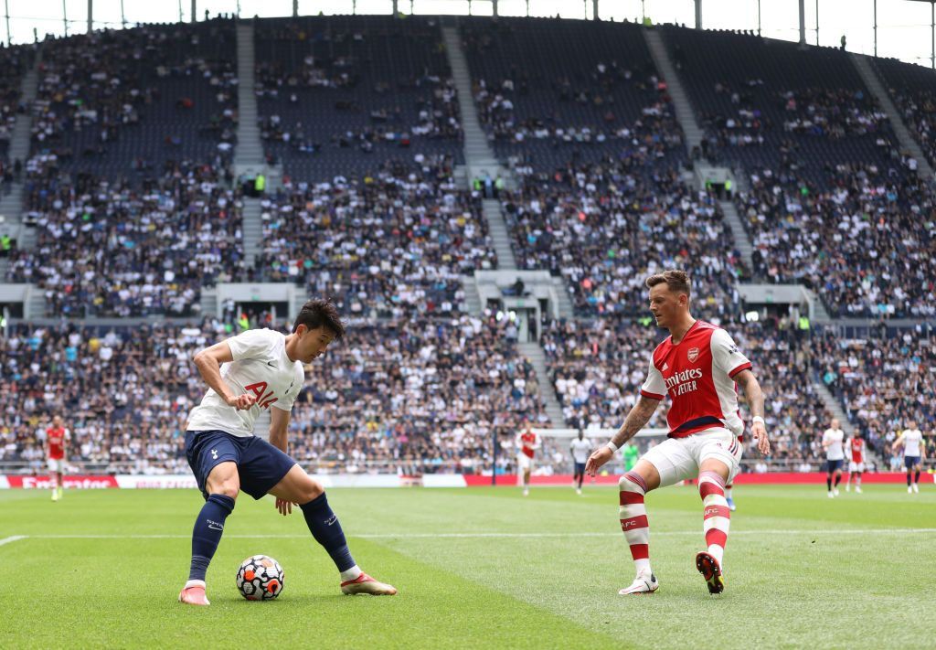 LONDON, ENGLAND - AUGUST 08: Son Heung-min of Tottenham Hotspur and Ben White of Arsenal  during the Pre-season friendly between Tottenham Hotspur and Arsenal at Tottenham Hotspur Stadium on August 08, 2021 in London, England. (Photo by Catherine Ivill/Getty Images)