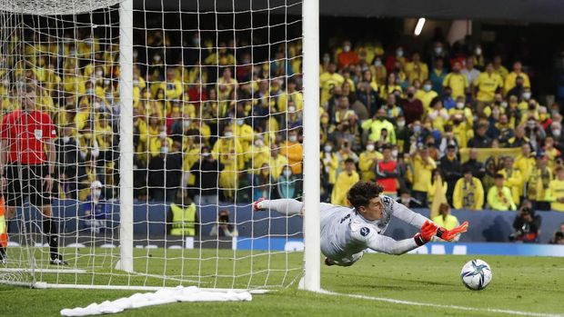 Chelsea's goalkeeper Kepa Arrizabalaga saves the final shot during the penalty shootout of the UEFA Super Cup soccer match between Chelsea and Villarreal at Windsor Park in Belfast, Northern Ireland, Wednesday, Aug. 11, 2021. (AP Photo/Peter Morrison)