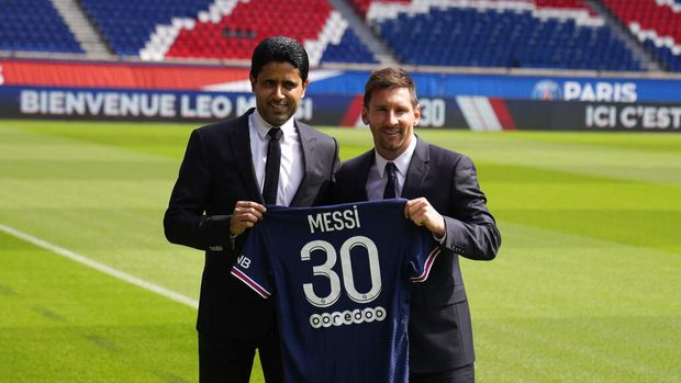 Lionel Messi, right, and PSG president Nasser Al-Al-Khelaifi hold Messi's jersey Wednesday, Aug. 11, 2021 at the Parc des Princes stadium in Paris. Lionel Messi said he's been enjoying his time in Paris
