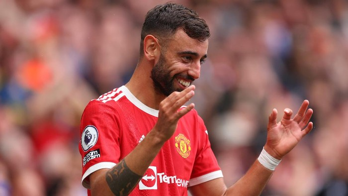 MANCHESTER, ENGLAND - AUGUST 14: Bruno Fernandes of Manchester United celebrates after scoring their sides fourth goal and his hat-trick during the Premier League match between Manchester United  and  Leeds United at Old Trafford on August 14, 2021 in Manchester, England. (Photo by Catherine Ivill/Getty Images,)