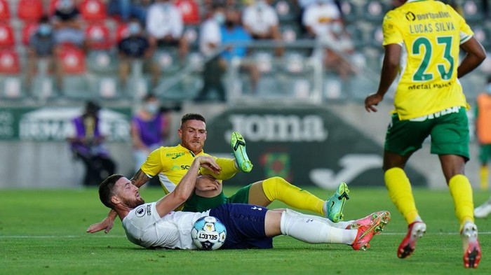 PACOS DE FERREIRA, PORTUGAL - AUGUST 19:  Matt Doherty of Tottenham Hotspur FC with Antunes of FC Pacos de Ferreira in action during the UEFA Europa Conference League match between FC Pacos de Ferreira and Tottenham Hotspur at Estadio Municipal da Capital do Movel on August 19, 2021 in Pacos de Ferreira, Portugal.  (Photo by Gualter Fatia/Getty Images)