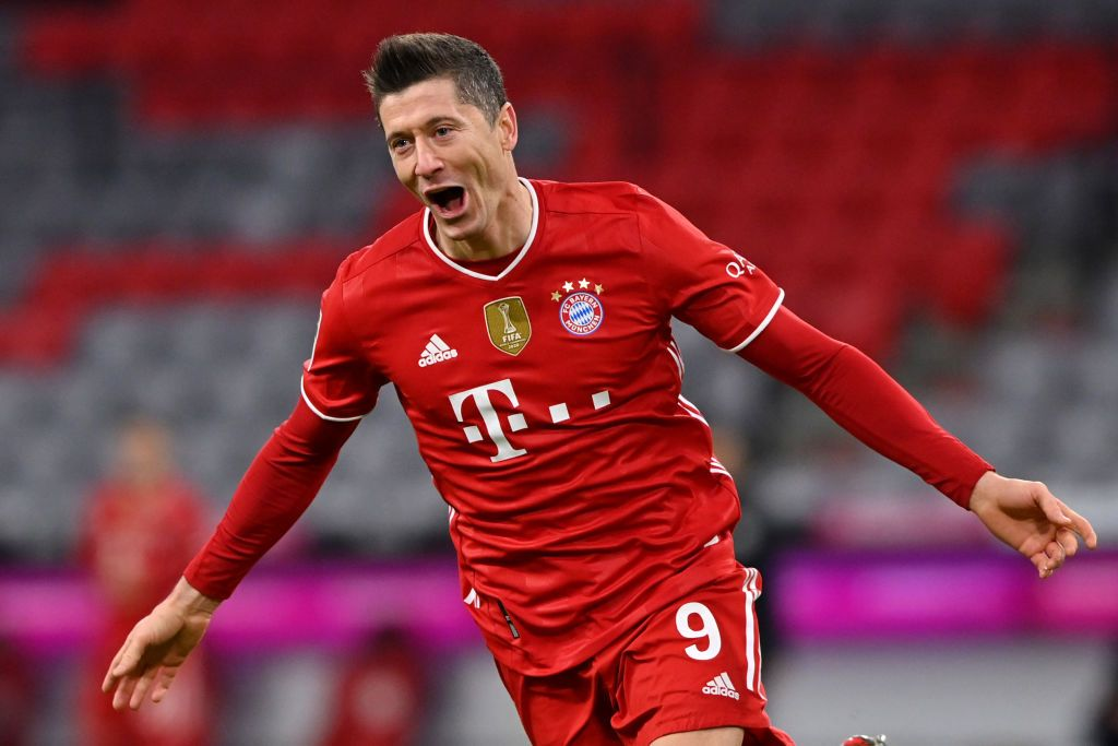 MUNICH, GERMANY - MARCH 06: Robert Lewandowski of FC Bayern Muenchen celebrates after scoring their team's fourth goal, completing his hat-trick during the Bundesliga match between FC Bayern Muenchen and Borussia Dortmund at Allianz Arena on March 06, 2021 in Munich, Germany. Sporting stadiums around Germany remain under strict restrictions due to the Coronavirus Pandemic as Government social distancing laws prohibit fans inside venues resulting in games being played behind closed doors. (Photo by Sebastian Widmann/Getty Images)