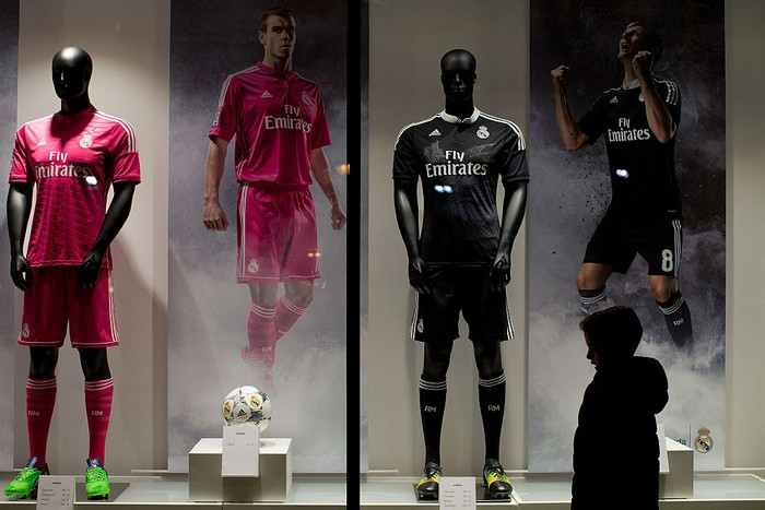 MADRID, SPAIN - DECEMBER 09:  A child walks infront of  the Real Madrid Officia Store window before the UEFA Champions League Group B match between Real Madrid CF and PFC Ludogorets Razgrad at Estadio Santiago Bernabeu outdoors on December 9, 2014 in Madrid, Spain.  (Photo by Gonzalo Arroyo Moreno/Getty Images)