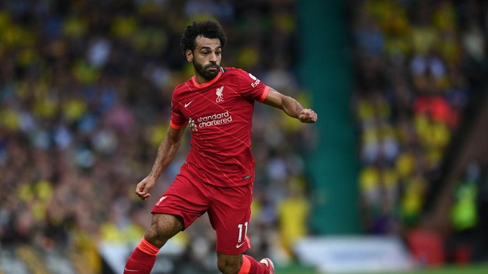 NORWICH, ENGLAND - AUGUST 14:  Mohamed Salah of Liverpool runs with the ball during the Premier League match between Norwich City  and  Liverpool at Carrow Road on August 14, 2021 in Norwich, England. (Photo by Shaun Botterill/Getty Images)
