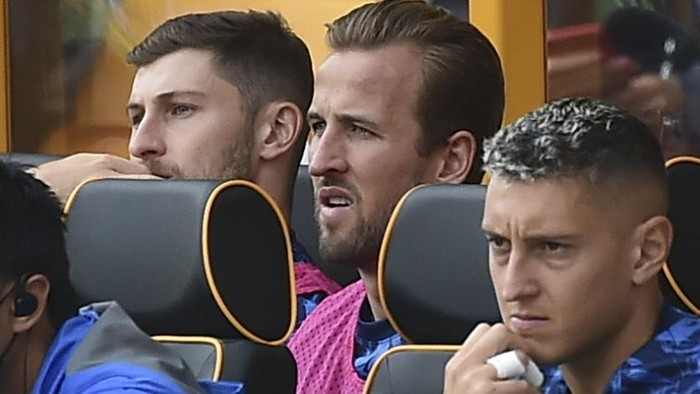 Tottenham's Harry Kane, back row, 2nd right, sits on the bench during the English Premier League soccer match between Wolverhampton Wanderers and Tottenham Hotspur at Molineux stadium in Wolverhampton, England, Sunday, Aug. 22, 2021. (AP Photo/Rui Vieira)