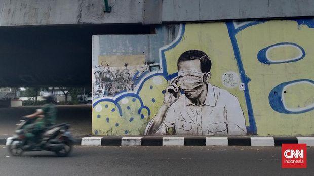 Mural Pria Mirip Jokowi dengan Masker Tutupi Mata Muncul di Kota Bandung