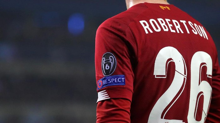 GENK, BELGIUM - OCTOBER 23: Detail view of the Champions League badge with the number 6 on and the Respect logo on the shirt of Andrew Robertson of Liverpool during the UEFA Champions League group E match between KRC Genk and Liverpool FC at Luminus Arena on October 23, 2019 in Genk, Belgium. (Photo by Catherine Ivill/Getty Images)