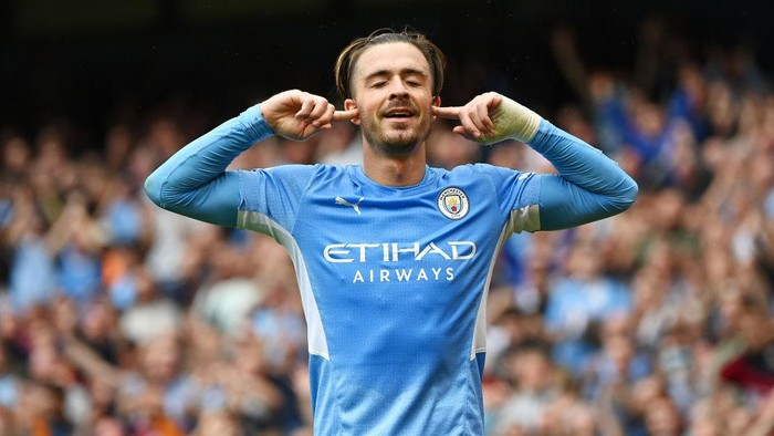 MANCHESTER, ENGLAND - AUGUST 21: Jack Grealish of Manchester City celebrates after scoring their sides second goal during the Premier League match between Manchester City and Norwich City at Etihad Stadium on August 21, 2021 in Manchester, England. (Photo by Shaun Botterill/Getty Images )