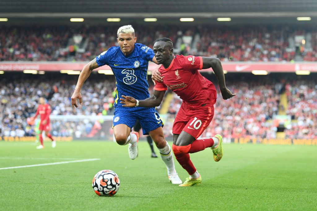 LIVERPOOL, ENGLAND - AUGUST 28: Sadio Mane of Liverpool battles for possession with Thiago Silva of Chelsea during the Premier League match between Liverpool  and  Chelsea at Anfield on August 28, 2021 in Liverpool, England. (Photo by Michael Regan/Getty Images)