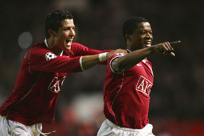 MANCHESTER, UNITED KINGDOM - APRIL 10:  Patrice Evra of Manchester United celebrates scoring his teams seventh goal with team mate Cristiano Ronaldo during the UEFA Champions League Quarter Final, second leg match between Manchester United and AS Roma at Old Trafford on April 10, 2007 in Manchester, England.  (Photo by Alex Livesey/Getty Images)