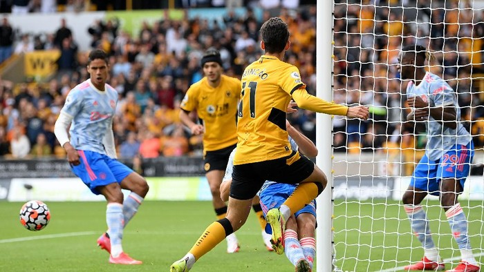 WOLVERHAMPTON, ENGLAND - AUGUST 29: Francisco Trincao of Wolverhampton Wanderers has a shot on goal during the Premier League match between Wolverhampton Wanderers  and  Manchester United at Molineux on August 29, 2021 in Wolverhampton, England. (Photo by Michael Regan/Getty Images)