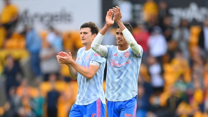 WOLVERHAMPTON, ENGLAND - AUGUST 29: Raphael Varane and Harry Maguire look on after the Premier League match between Wolverhampton Wanderers  and  Manchester United at Molineux on August 29, 2021 in Wolverhampton, England. (Photo by Michael Regan/Getty Images)