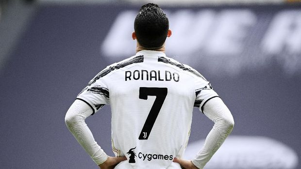 Juventus' Cristiano Ronaldo looks on during a Serie A soccer match between Juventus and Genoa, at the Turin Allianz stadium, Italy, Sunday, April 11, 2021. Ronaldo is headed back to Manchester United. The English club said Friday, Aug. 27, 2021, it has reached an agreement with Juventus for the transfer of the 36-year-old Portugal forward, subject to agreement of personal terms, visa and a medical examination. (Marco Alpozzi/LaPresse via AP)