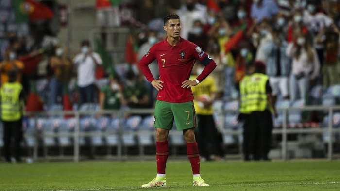 Portugals forward Cristiano Ronaldo reacts after the FIFA World Cup Qatar 2022 European qualifying round group A football match between Portugal and Republic of Ireland at the Algarve stadium in Loule, near Faro, southern Portugal, on September 1, 2021. (Photo by CARLOS COSTA / AFP)