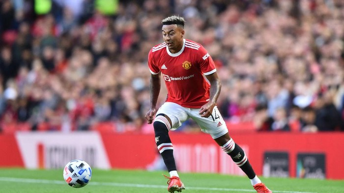 MANCHESTER, ENGLAND - JULY 28: Jesse Lingard of Manchester United runs with the ball during the pre-season friendly match between Manchester United and Brentford at Old Trafford on July 28, 2021 in Manchester, England. (Photo by Nathan Stirk/Getty Images)