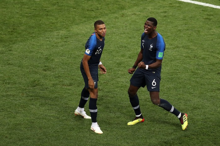 MOSCOW, RUSSIA - JULY 15:  Kylian Mbappe of France celebrates with teammate Paul Pogba after scoring his teams fourth goal during the 2018 FIFA World Cup Final between France and Croatia at Luzhniki Stadium on July 15, 2018 in Moscow, Russia.  (Photo by Catherine Ivill/Getty Images)