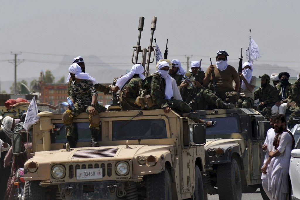 Taliban fighters atop Humvee vehicles parade along a road to celebrate after the US pulled all its troops out of Afghanistan, in Kandahar on September 1, 2021 following the Talibans military takeover of the country. (Photo by JAVED TANVEER / AFP)