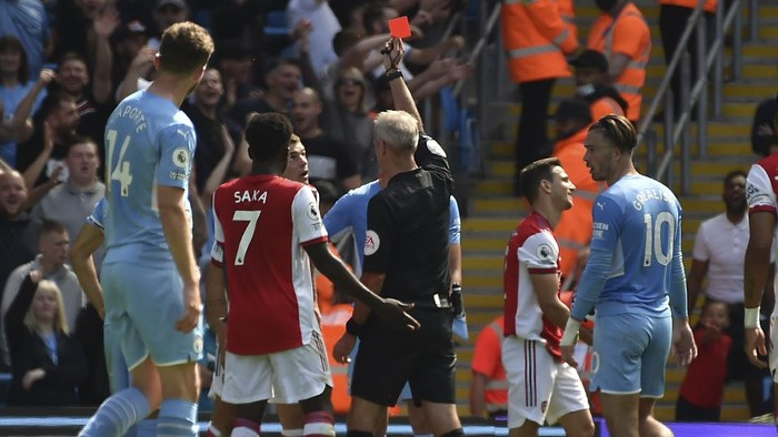 Arsenals Granit Xhaka sees the red card during the English Premier League soccer match between Manchester City and Arsenal at Etihad stadium in Manchester, England, Saturday, Aug. 28, 2021. (AP Photo/Rui Vieira)