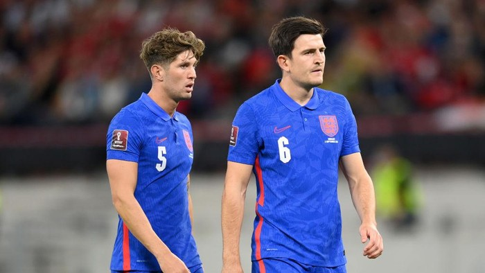 BUDAPEST, HUNGARY - SEPTEMBER 02: John Stones and Harry Maguire of England  look on  during the 2022 FIFA World Cup Qualifier match between Hungary and England at Stadium Puskas Ferenc on September 02, 2021 in Budapest, Hungary. (Photo by Michael Regan/Getty Images)