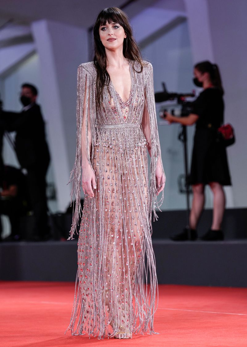 Dakota Johnson poses for photographers upon arrival at the premiere of the film 'The Lost Daughter' during the 78th edition of the Venice Film Festival in Venice, Italy, Friday, Sep, 3, 2021. (AP Photo/Domenico Stinellis)