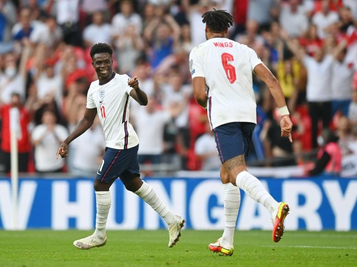 LONDON, ENGLAND - SEPTEMBER 05: Bukayo Saka of England celebrates after scoring their teams fourth goal  during the 2022 FIFA World Cup Qualifier match between England and Andorra at Wembley Stadium on September 05, 2021 in London, England. (Photo by Shaun Botterill/Getty Images)
