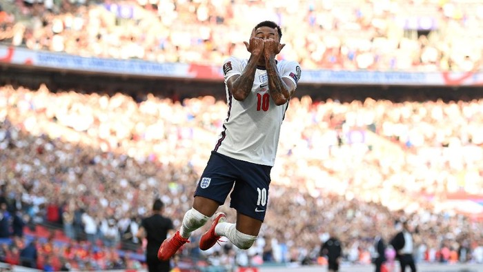 LONDON, ENGLAND - SEPTEMBER 05: Jesse Lingard of England  celebrates after scoring their teams first goal  during the 2022 FIFA World Cup Qualifier match between England and Andorra at Wembley Stadium on September 05, 2021 in London, England. (Photo by Shaun Botterill/Getty Images)