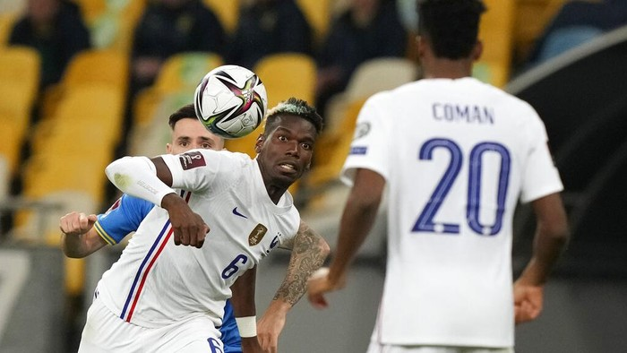 Frances Paul Pogba in action during the World Cup 2022 group D qualifying soccer match between Ukraine and France at the Olimpiyskiy Stadium in Kyiv, Ukraine, Saturday, Sept. 4, 2021. (AP Photo/Efrem Lukatsky)
