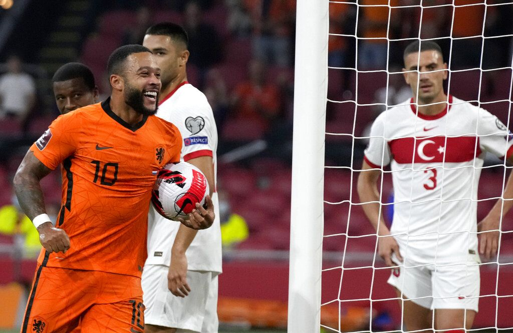 Memphis Depay of the Netherlands celebrates scoring his side's first goal during the World Cup 2022 group G qualifying soccer match between the Netherlands and Montenegro at the Philips stadium in Eindhoven, Netherlands, Saturday, Sept. 4, 2021. (AP Photo/Peter Dejong)