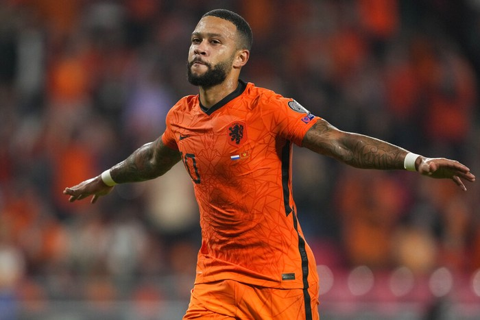 Memphis Depay of the Netherlands celebrates scoring his sides first goal during the World Cup 2022 group G qualifying soccer match between the Netherlands and Montenegro at the Philips stadium in Eindhoven, Netherlands, Saturday, Sept. 4, 2021. (AP Photo/Peter Dejong)