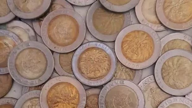 Uang Koin 1000 rupiah kelapa sawit. Ist