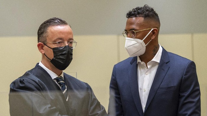 Professional footballer and former national player Jerome Boateng, right, stands with his lawyer Kai Walden, left, at the beginning of the trial against him at the District Court in Munich, Germany, Thursday, Sept. 9, 2021. Boateng is being tried on charges of assault. (Peter Kneffel /dpa via AP)