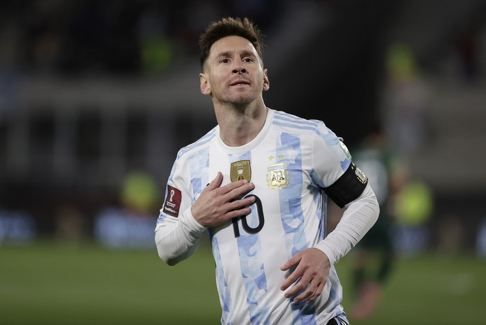 Argentinas Lionel Messi celebrates scoring the opening goal against Bolivia during a qualifying soccer match for the FIFA World Cup Qatar 2022, in Buenos Aires, Argentina, Thursday, Sept. 9, 2021. (Juan Roncoroni/Pool via AP)