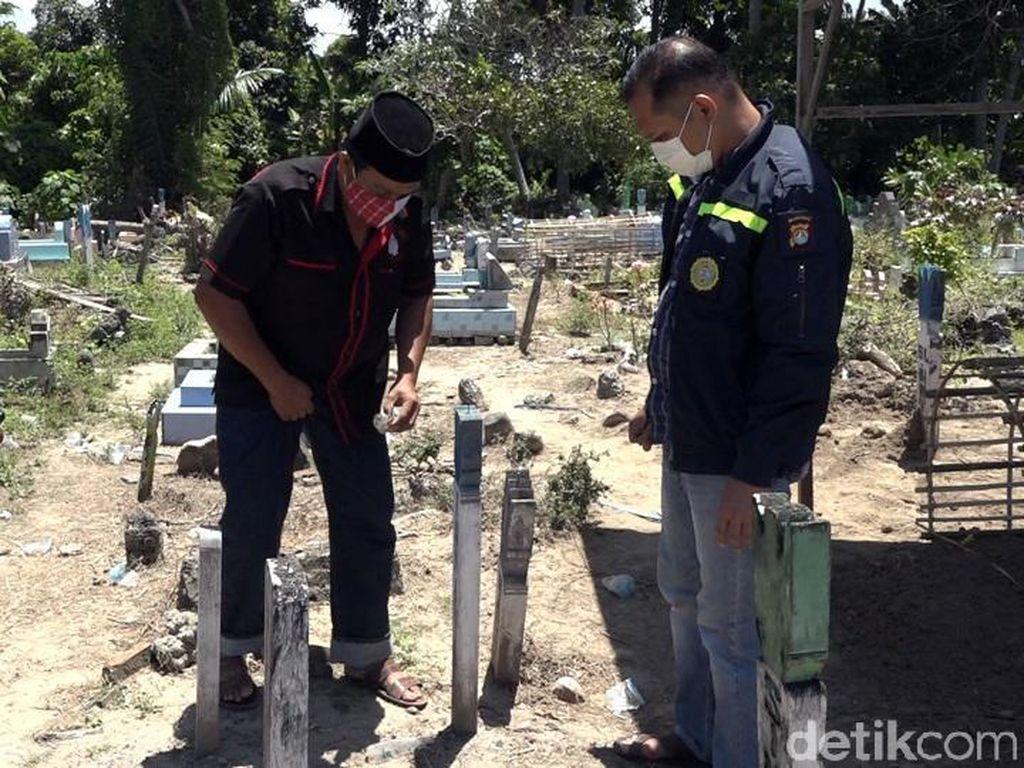 Polisi Selidiki Botol Berisi 7 Foto Wanita Tertanam di Kuburan Polman
