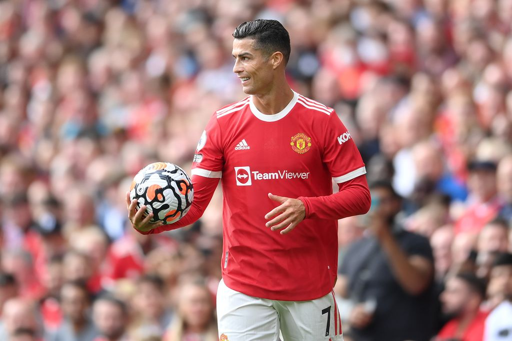 MANCHESTER, ENGLAND - SEPTEMBER 11: Cristiano Ronaldo of Manchester United reacts as he holds the match ball during the Premier League match between Manchester United and Newcastle United at Old Trafford on September 11, 2021 in Manchester, England. (Photo by Laurence Griffiths/Getty Images)