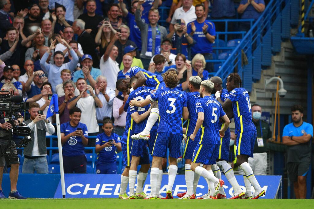 Chelsea players celebrate after Chelsea's Mateo Kovacic scored his side's second goal during the English Premier League match between Chelsea and Aston Villa at the Stamford Bridge Stadium in London, Saturday, Sept. 11, 2021. (AP Photo/Ian Walton)