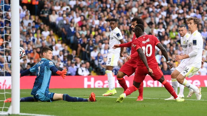 LEEDS, ENGLAND - SEPTEMBER 12: Mohamed Salah of Liverpool scores their sides first goal past Illan Meslier of Leeds United during the Premier League match between Leeds United and Liverpool at Elland Road on September 12, 2021 in Leeds, England. (Photo by Laurence Griffiths/Getty Images)