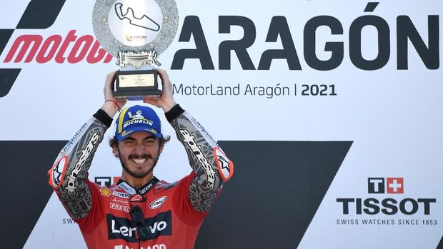 Ducati Italian rider Francesco Bagnaia celebrates on the podium after winning the Moto Grand Prix of Aragon at the Motorland circuit in Alcaniz on September 12, 2021. (Photo by LLUIS GENE / AFP)