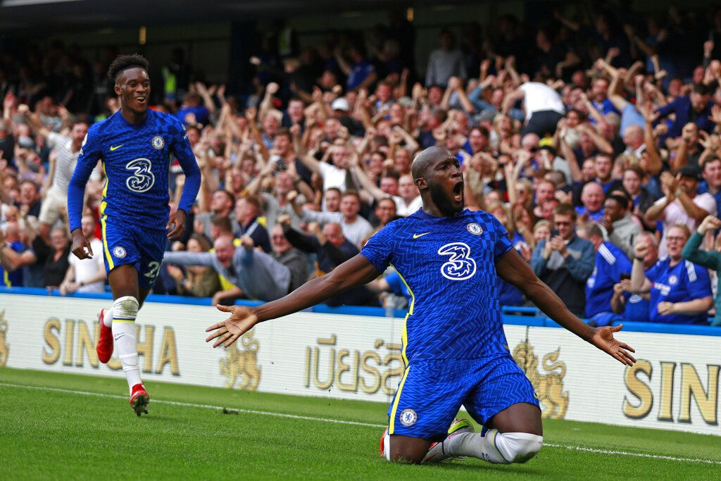 Chelsea's Romelu Lukaku, right, celebrates after scoring his side's opening goal during the English Premier League match between Chelsea and Aston Villa at the Stamford Bridge Stadium in London, Saturday, Sept. 11, 2021. (AP Photo/Ian Walton)