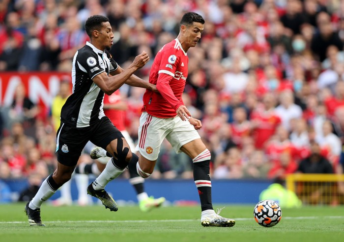 MANCHESTER, ENGLAND - SEPTEMBER 11: Cristiano Ronaldo of Manchester United runs with the ball before going on to score his sides second goal during the Premier League match between Manchester United and Newcastle United at Old Trafford on September 11, 2021 in Manchester, England. (Photo by Clive Brunskill/Getty Images)