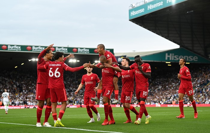 LEEDS, ENGLAND - SEPTEMBER 12: Fabinho of Liverpool celebrates with Thiago Alcantara and team mates after scoring their sides second goal during the Premier League match between Leeds United and Liverpool at Elland Road on September 12, 2021 in Leeds, England. (Photo by Shaun Botterill/Getty Images)