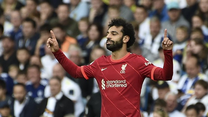 Liverpools Mohamed Salah celebrates after scoring the opening goal during the English Premier League soccer match between Leeds United and Liverpool at Elland Road, Leeds, England, Sunday, Sept. 12, 2021. (AP Photo/Rui Vieira)