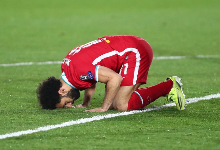 MADRID, SPAIN - APRIL 06: Mohamed Salah of Liverpool celebrates after scoring their teams first goal during the UEFA Champions League Quarter Final match between Real Madrid and Liverpool FC at Estadio Alfredo Di Stefano on April 06, 2021 in Madrid, Spain. Sporting stadiums around Spain remain under strict restrictions due to the Coronavirus Pandemic as Government social distancing laws prohibit fans inside venues resulting in games being played behind closed doors. (Photo by Fran Santiago/Getty Images)