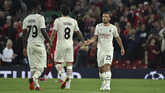 AC Milans Alessandro Florenzi, right, reacts at the end of the Champions League Group B soccer match between Liverpool and AC Milan at Anfield, in Liverpool, England, Wednesday Sept. 15, 2021. Liverpool won the match 3-2. (AP Photo/Rui Vieira)